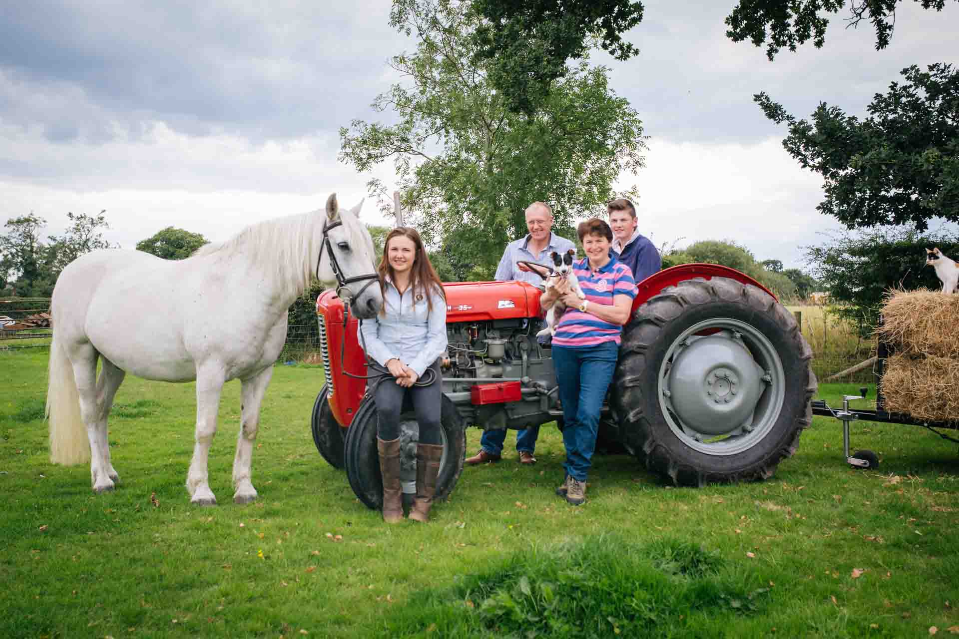 Joanna Eardley Photography - The Whole family. Family portraits with with the horse, dog and cat and vintage tractor